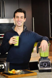 Lenny Gale with green smoothie and Vitamix Pro 750.